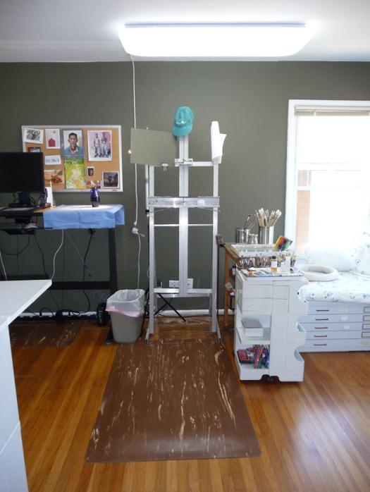 Studio with new cushy floor mat, lighting and dark painted wall