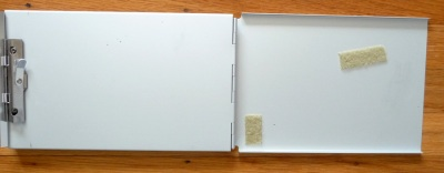 Clipboard for drawing on left, velcroed spots for palette on right