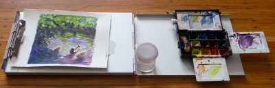 As used, with sketch on left;  palette & water container on right