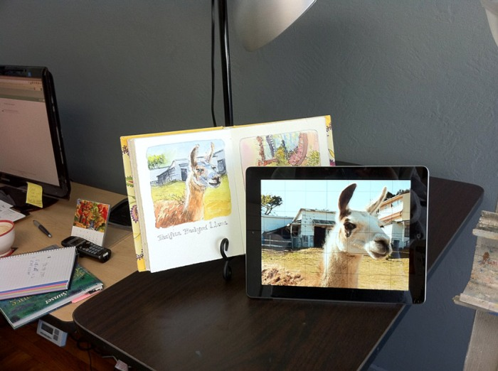 sketchbook and iPad set up by easel