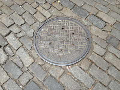 """Cobblestone street and """"Made in  India"""" NYC manhole cover"""