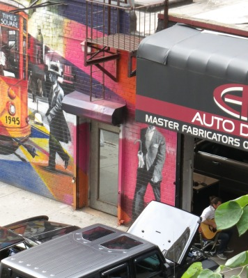 Murals and music everywhere in New York (see employee playing guitar in car shop driveway)
