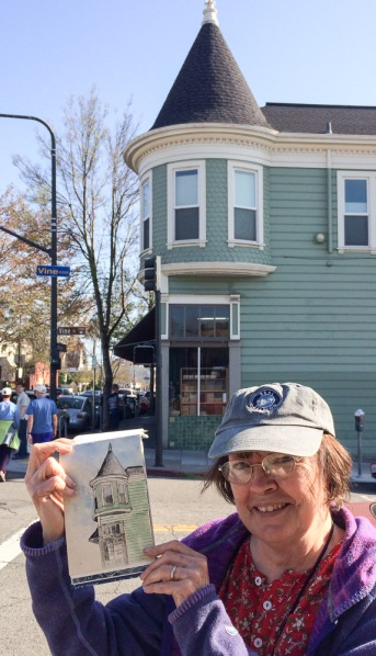Carol holding her sketch of the corner of Shattuck and Vine