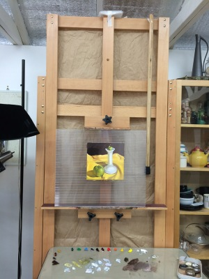 Easel with cane hanging when not in use