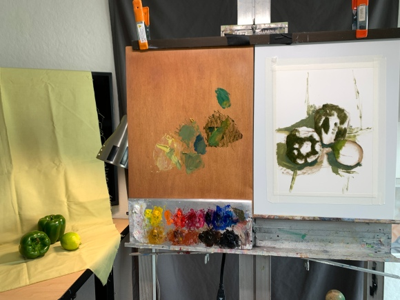 Setup and beginning of still life painting of green peppers